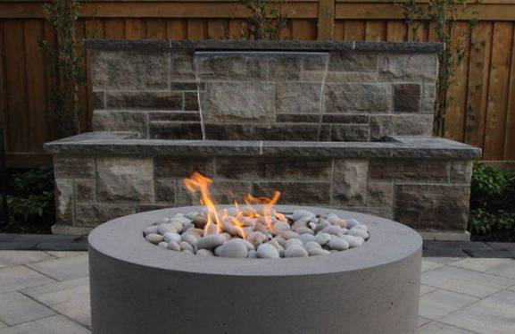 fire and water feature in backyard landscape