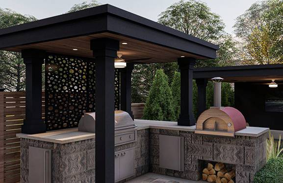 outdoor kitchen in backyard with barbecue and cabana