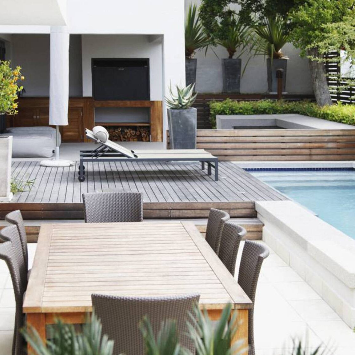 inground pool and patio project by landscaping company