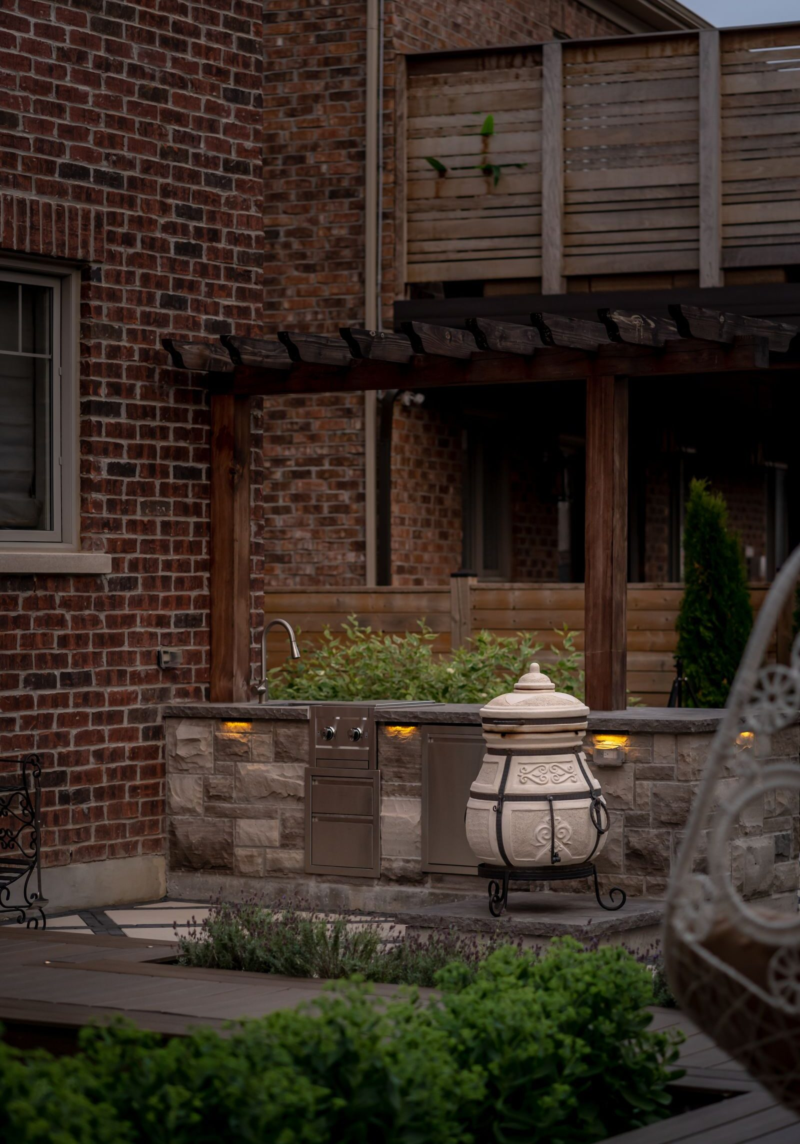outdoor kitchen design by landscaping company in kleinburg